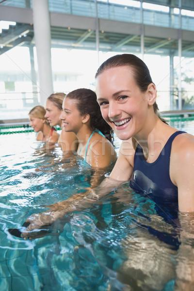 Female fitness class doing aqua aerobics Stock photo © wavebreak_media