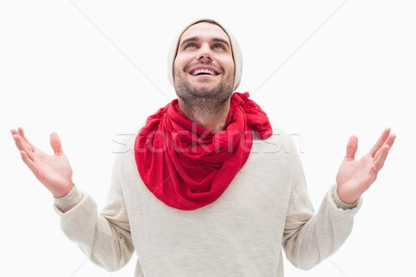 Aantrekkelijk jonge man warm kleding handen omhoog witte Stockfoto © wavebreak_media
