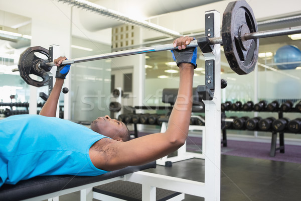 Determinado moço barbell ginásio vista lateral Foto stock © wavebreak_media