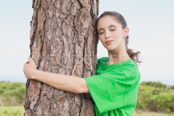 Female environmental activist hugging tree trunk Stock photo © wavebreak_media