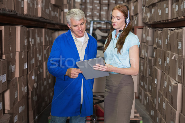 Warehouse manager and foreman looking at clipboard Stock photo © wavebreak_media