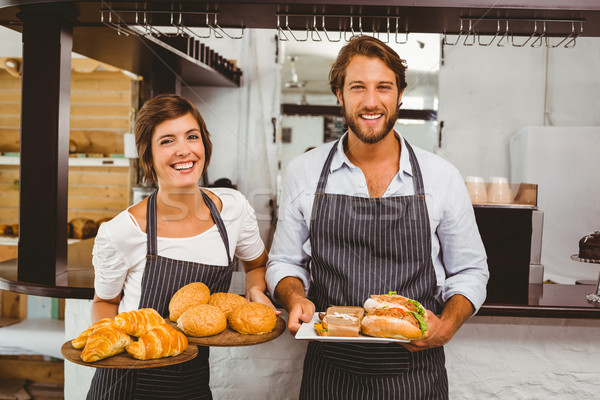 Happy servers holding plates of food Stock photo © wavebreak_media