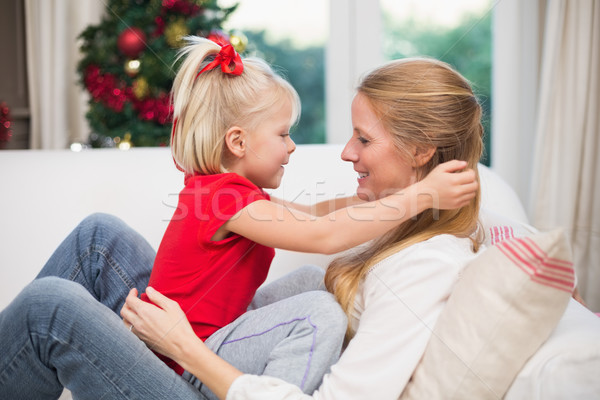 Cute daughter and mother celebrating christmas Stock photo © wavebreak_media