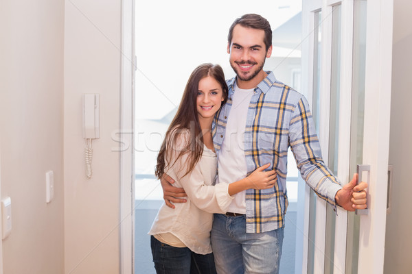 Cute couple walking through the door Stock photo © wavebreak_media