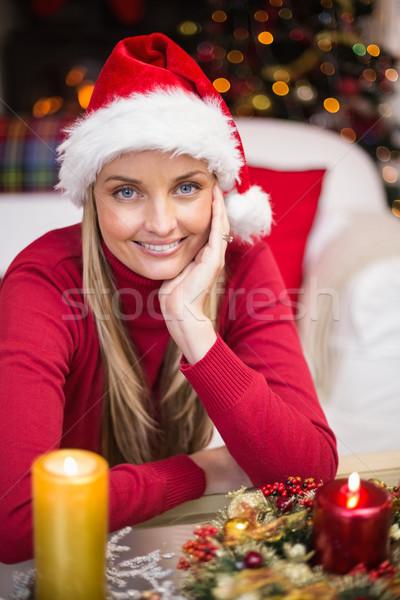 Happy blonde woman in santa hat Stock photo © wavebreak_media