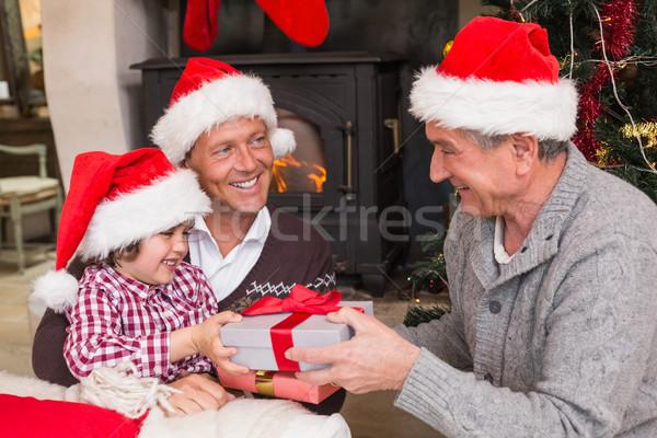 Three generation family celebrating christmas Stock photo © wavebreak_media