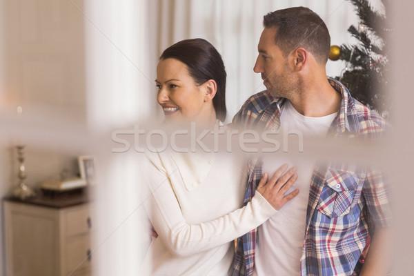 Stockfoto: Liefde · paar · knuffelen · home · woonkamer