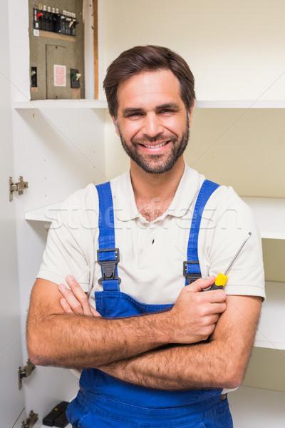 мастер на все руки улыбаясь камеры кухне человека счастливым Сток-фото © wavebreak_media
