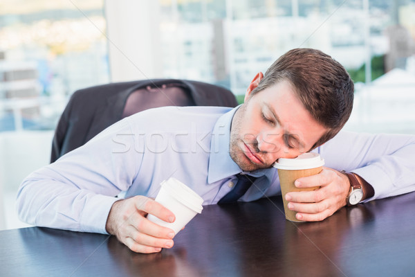 Exhausted businessman sleeping at his desk Stock photo © wavebreak_media