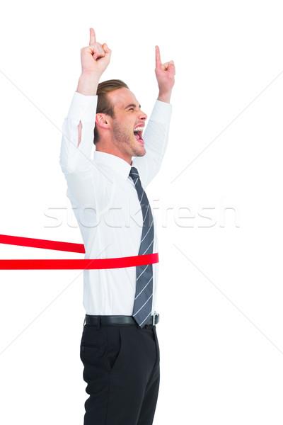 Feliz empresario senalando hasta blanco Foto stock © wavebreak_media