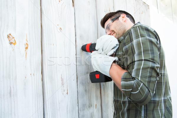 Trabalhador mão três de um tipo cabine vista lateral Foto stock © wavebreak_media
