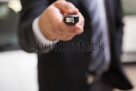 Close up of businessman giving car key Stock photo © wavebreak_media