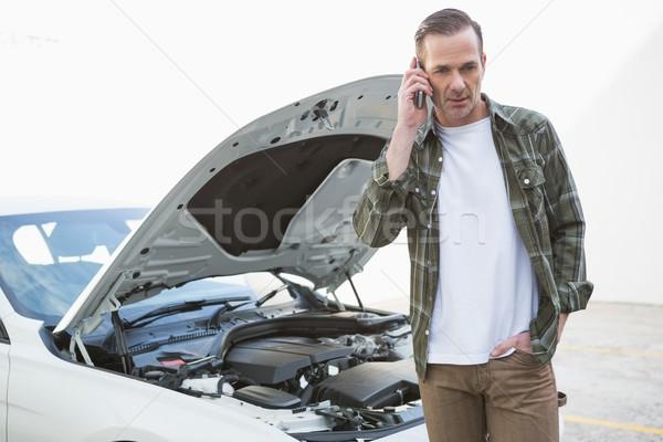 Desperate man calling for assistance after breaking down Stock photo © wavebreak_media