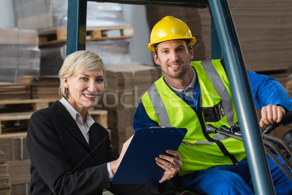 Forklift driver and manager smiling at camera Stock photo © wavebreak_media