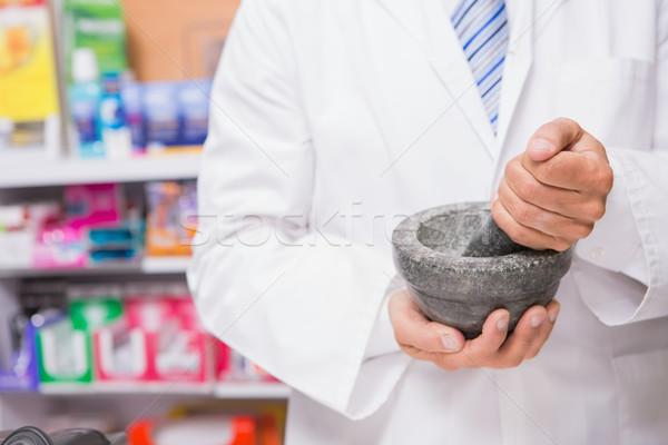 Pharmacist in lab coat mixing a medicine Stock photo © wavebreak_media