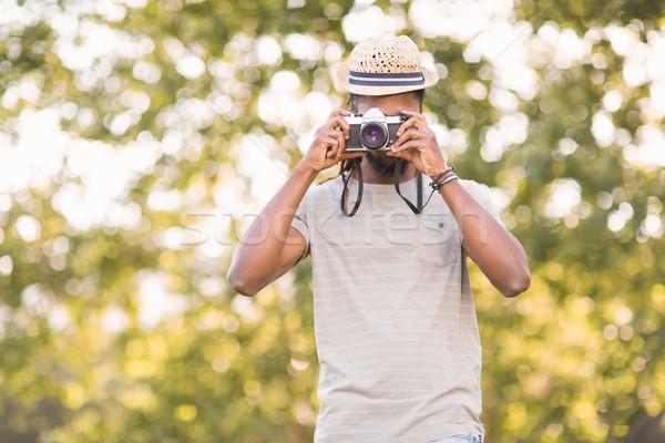 Handsome hipster using vintage camera Stock photo © wavebreak_media