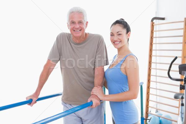 Senior man and his coach smiling at camera  Stock photo © wavebreak_media