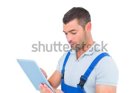 Mężczyzna stolarz cyfrowe tabletka biały człowiek Zdjęcia stock © wavebreak_media