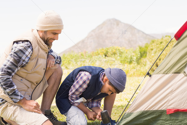 Father and son pitching their tent Stock photo © wavebreak_media