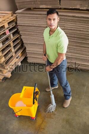 Man moping warehouse floor Stock photo © wavebreak_media