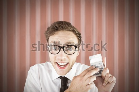 Geeky businessman using a calculator Stock photo © wavebreak_media