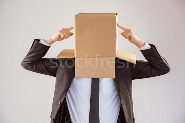 Anonim üzletember mutat doboz szürke öltöny Stock fotó © wavebreak_media