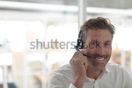 человека гарнитура набрав ноутбука служба компьютер Сток-фото © wavebreak_media