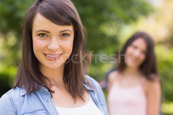 Dość student uśmiechnięty kamery na zewnątrz kampus Zdjęcia stock © wavebreak_media