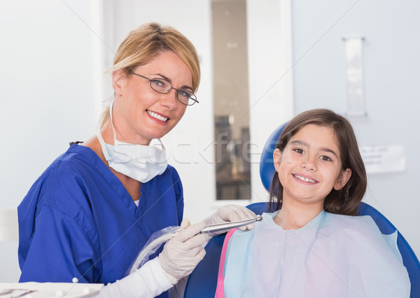 Portrait of a smiling pediatric dentist and young patient Stock photo © wavebreak_media