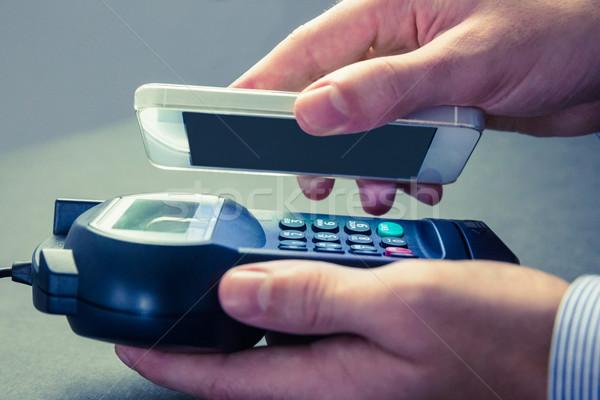 Férfi okostelefon expressz illetmény szürke üzlet Stock fotó © wavebreak_media