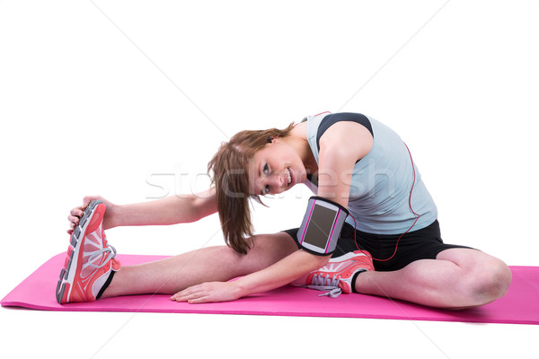 Pretty brunette looking at camera and stretching her leg on exer Stock photo © wavebreak_media
