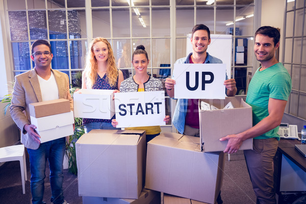 Creative business team holding cardboard written start up Stock photo © wavebreak_media