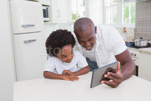 Father and son using digital tablet Stock photo © wavebreak_media