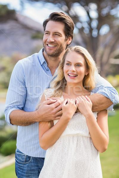 Cute couple date bras autour permanent Photo stock © wavebreak_media