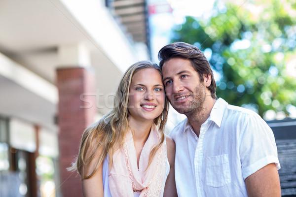 Smiling couple sitting closely together Stock photo © wavebreak_media