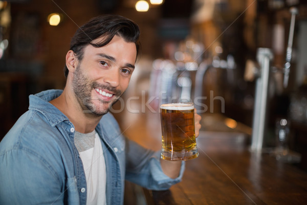 Portrait of man holding beer glass at pub Stock photo © wavebreak_media