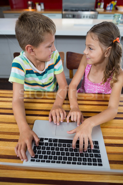 Siblings interacting with each other while using laptop Stock photo © wavebreak_media