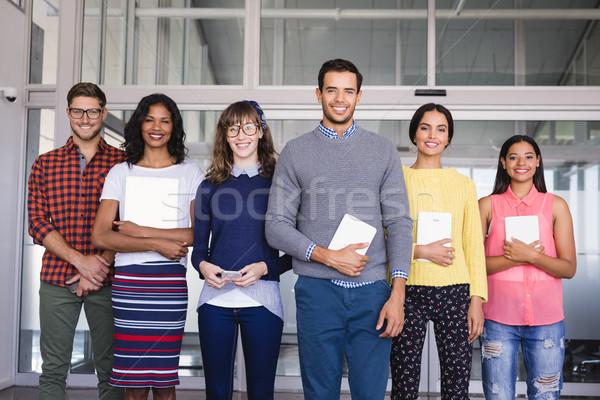 Retrato colegas pie oficina negocios empresario Foto stock © wavebreak_media