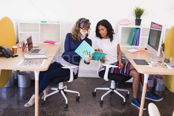 Businesswomen discussing while working in office Stock photo © wavebreak_media