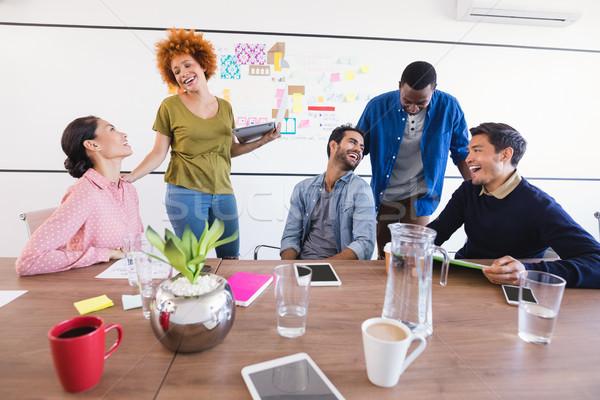 Happy business people at desk against whiteboard Stock photo © wavebreak_media