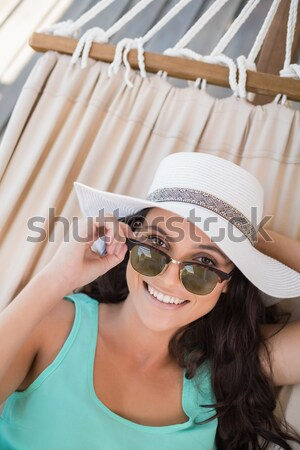 Close up woman wearing hat while photographing Stock photo © wavebreak_media