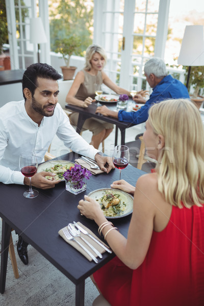 Couple interacting while having meal Stock photo © wavebreak_media