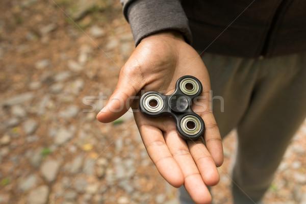 Man holding a fidget spinner Stock photo © wavebreak_media