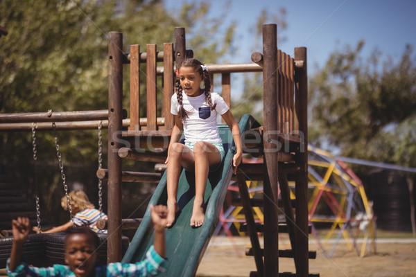Menina jogar deslizar escolas recreio madeira Foto stock © wavebreak_media