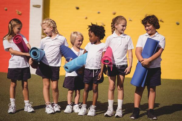 écolières autre exercice fille herbe Photo stock © wavebreak_media