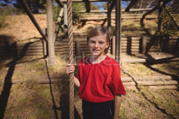 Portré mosolyog lány tart kötél akadályfutás Stock fotó © wavebreak_media