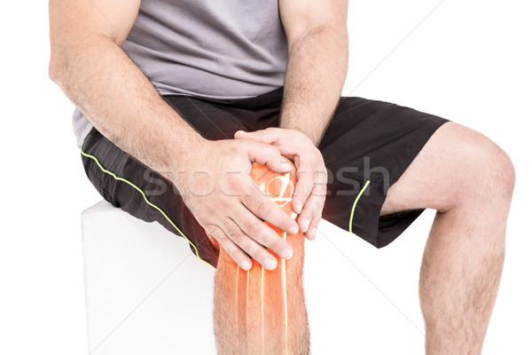Man suffering with knee inflammation against white background Stock photo © wavebreak_media