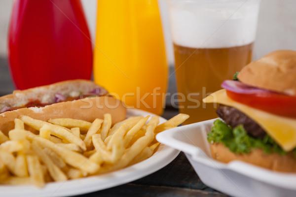 Primo piano hamburger patatine fritte tavola alimentare party Foto d'archivio © wavebreak_media