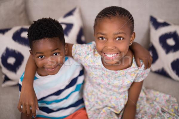 Portret glimlachend broers en zussen vergadering sofa home Stockfoto © wavebreak_media