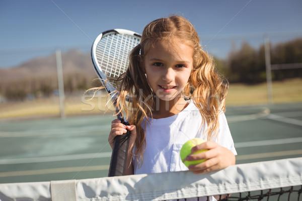 Portré lány tart teniszütő labda áll Stock fotó © wavebreak_media